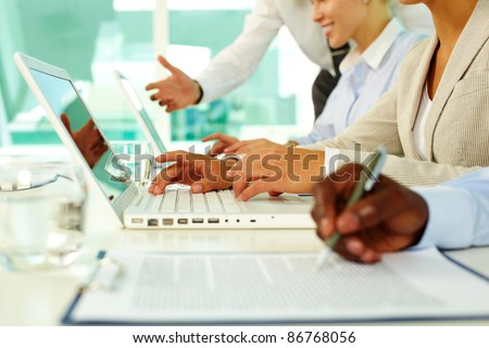 Female hands typing on computer in office