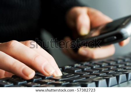 Female hands typing on computer keyboard.