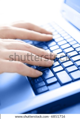 Female hands typing on keyboard - High key image with selective focus