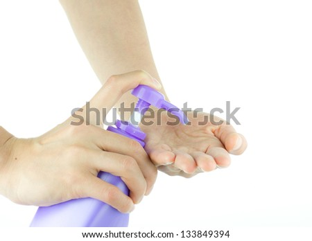 Female hands using hand sanitizer