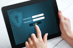 Female hands using tablet pc protected with password