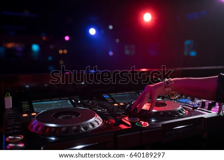 Female hands with a dj mixer #640189297
