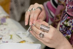 Female hands with a ring do a decoupage of paper