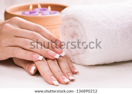 female hands with aromatic candles and towel