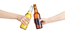 female hands with cold beer bottles making toast isolated on white background