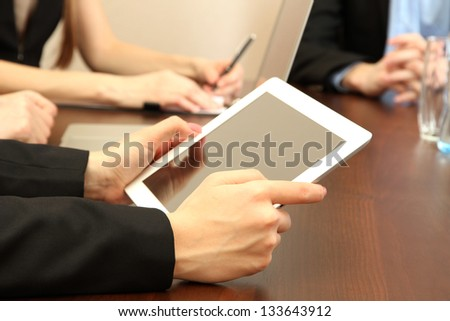 Female hands with digital tablet on office background. - stock photo