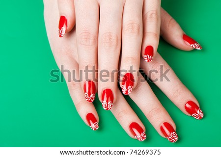 Female hands with French manicure. It is isolated on a green background
