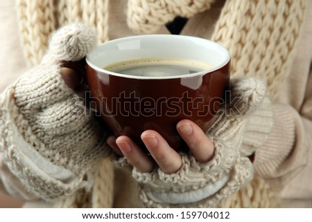 Female hands with hit drink, on color background #159704012