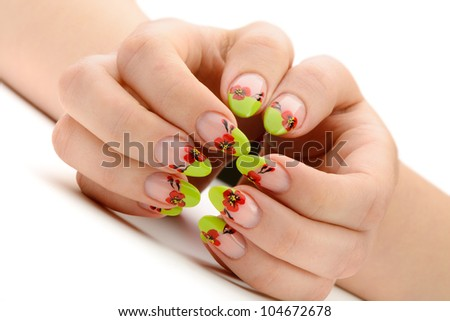 Female hands with manicure closeup. Isolated on white. Drawing red poppy flowers.