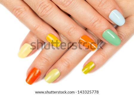female hands with nail polish color. isolated on white background