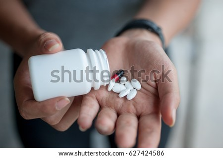 Female Hands with prescription drugs,Patient hands on medication prescribed by doctor.