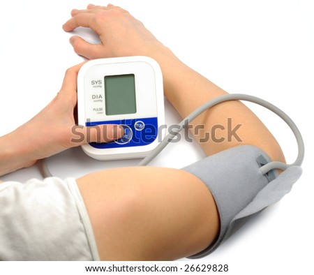 Female hands with pressure meter isolated over white