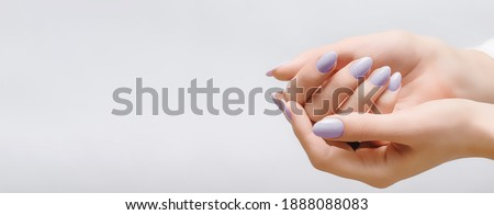 Female hands with rose nail design. Pink glitter nail polish manicure on white background. Nail design copy space Stock photo ©