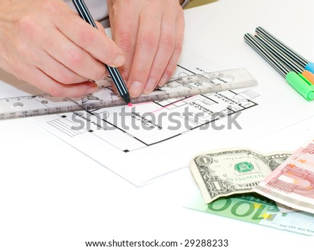 Female hands with ruler and pencil writing on blueprint - stock photo