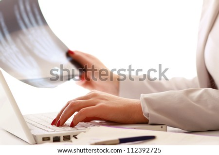 Female hands working on a laptop, closeup