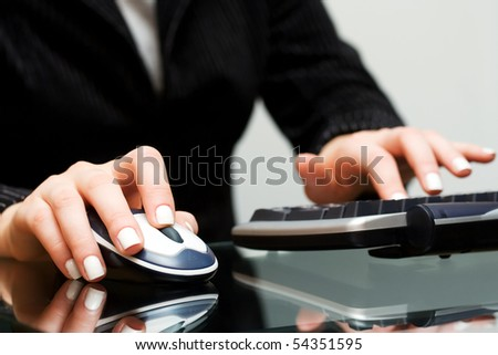 Female hands working on computer.