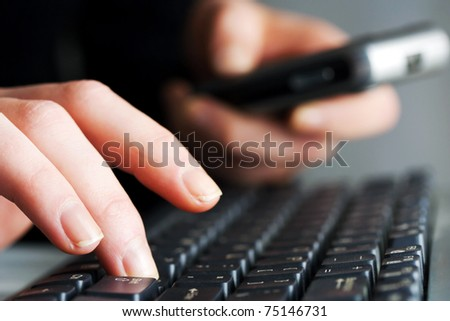 Female hands working on computer