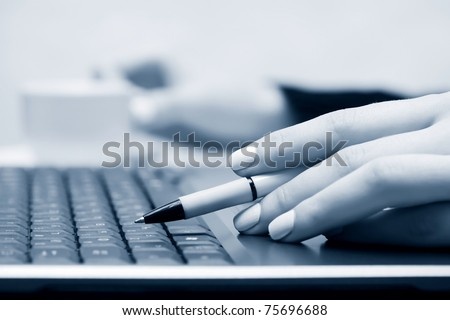Female hands working on the laptop