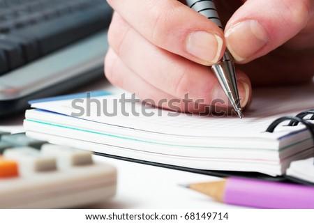 Female hands writing.
