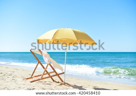 Female hat, chair and umbrella on stunning tropical beach vacation background #420458410