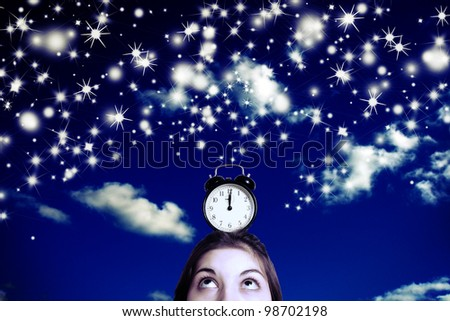 Female head with an alarm clock in the night sky. - stock photo