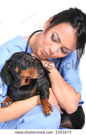 Female Healthcare Worker or Veterinarian with Dog