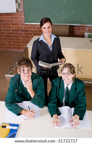 female high school teacher and her students in classroom