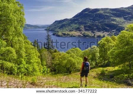 Female hiker looking at Ullswater, Lake District National Park, Cumbria, England.