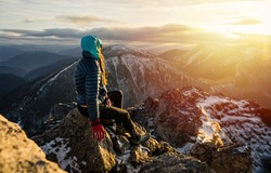 Female hiker takes a break and enjoys mountain views. Goals and achievements concept photo composite.