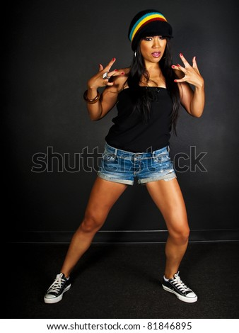female hip hop dancer posing with west side hand gesture
