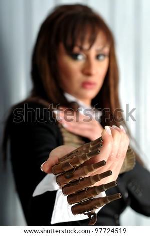 Female holding a bullet belt