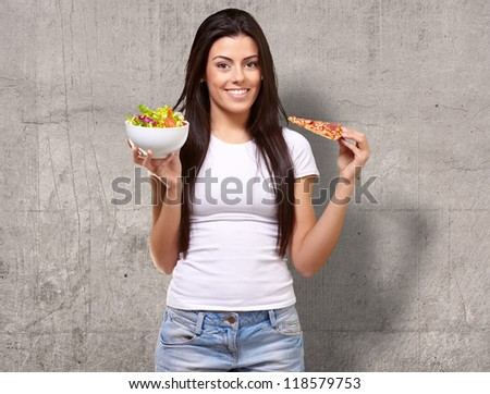 Female Holding A Piece Of Pizza And Salad Bowl, Background