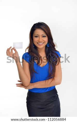 female holding business card