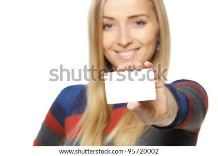 Female holding credit card, shallow depth of field, focus on the credit card, over white background