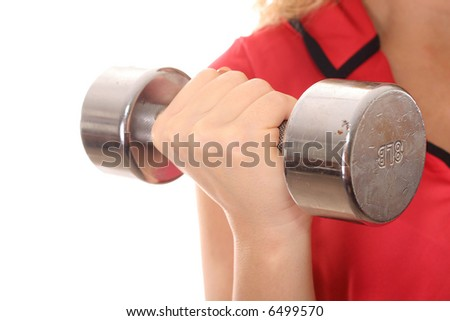 female holding dumbbell weight up close