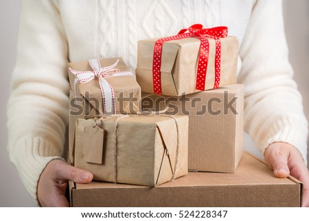 Female holding stack of christmas presents. christmas concept #524228347