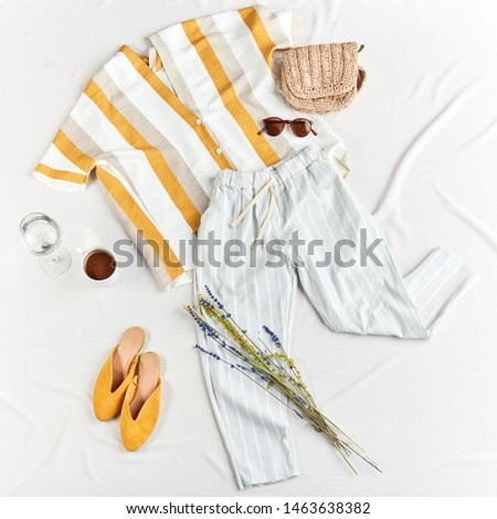 Female holiday clothes and accessories, flat lay, top view.fashion and design. summer outfit for holidaymakers