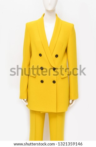 female in yellow coat and yellow pants on a dummy isolated-white background