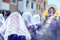 Female incense burners following the procession of the Lord of Miracles every October in Lima - Peru