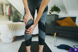 Female injured her knee during home workout in her room