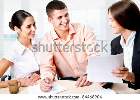 Female insurance agent is talking with a young couple