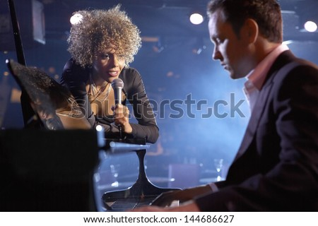 Female jazz singer and pianist on stage