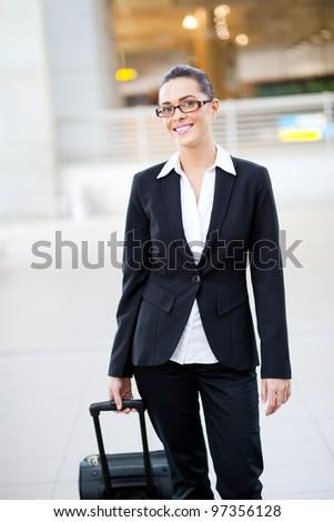 female jetsetter walking in airport - stock photo