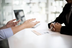 Female job applicants presenting a resume in the hands of a manager, presenting their ability to apply for the interviewer to see the ability and attitude of the candidate to consider for employment.