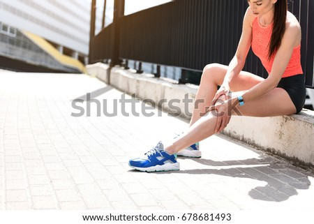 Female jogger feels pain in foot #678681493
