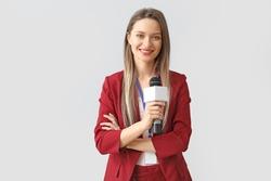 Female journalist on light background