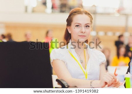 female judge referee of a sports event at the table.