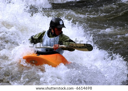 female kayak play boat competitor surfing river wave