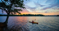 Female Kayaker on Lake Keowee at Sunset