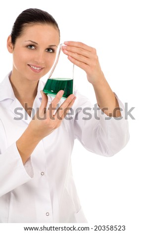 Female lab worker holding flask - stock photo